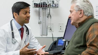 Doctor speaking to his patient at a clinic